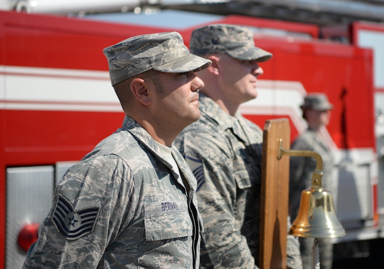 Tech. Sgt. Daniel Bernal, 9th Civil Engineer Squadron battalion chief, stands waiting to ring a bell Sept. 9, 2016, at Beale Air Force Base, California. The bell is rung three times during the ceremony to honor the fallen. (U.S Air Force photo/ Tristan D. Viglianco)