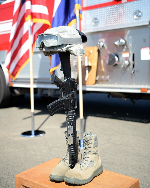 A pair of boots and a rifle stand a reminder of those lost in the wars since 9/11 Sept. 9, 2016, at Beale Air Force Base, California. Beale held a 9/11 first responder memorial ceremony to honor the firefighters, police officers, and medical responders who responded to the event. (U.S Air Force photo/ Tristan D. Viglianco)