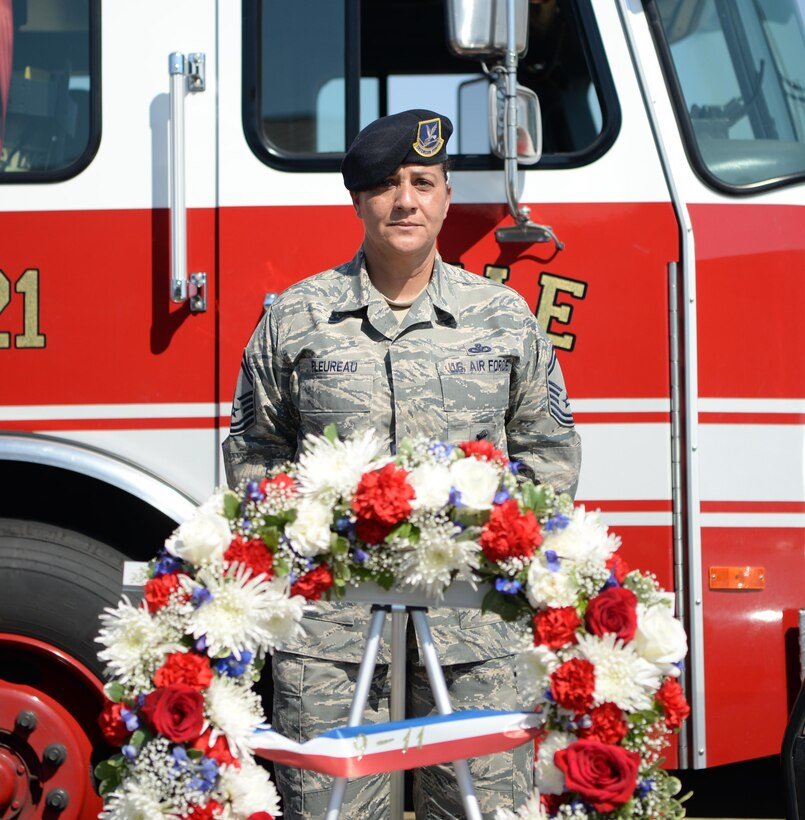 Senior Master Sgt. Bea Fleureau, 9th Security Forces Squadron operations superintendent, presides over a wreath laying Sept. 9, 2016, at Beale Air Force Base, California. The upcoming anniversary of 9/11 marks 15 years since the attacks. (U.S Air Force photo/ Tristan D. Viglianco)