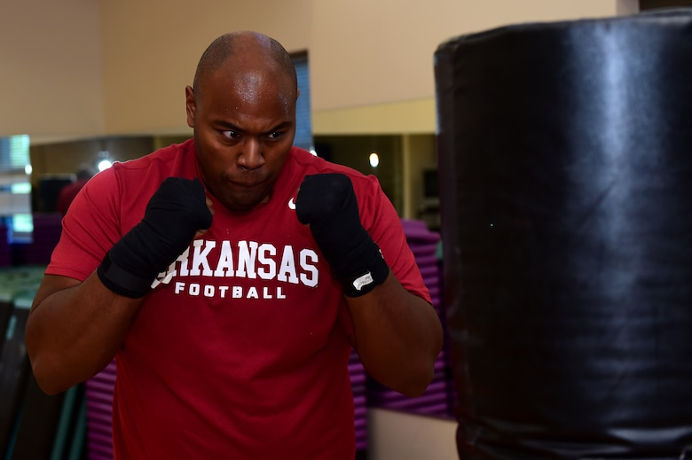 U.S. Army Sgt. Anthony Lee, 743D Military Intelligence Battalion network infrastructure manager, spars with a punching bag Sept. 9, 2016, at the Buckley Fitness Center on Buckley Air Force Base, Colo. The fitness center provides service members, retirees and dependents with different options to stay healthy and fit to fight. (U.S. Air Force photo by Airman 1st Class Gabrielle Spradling/Released)