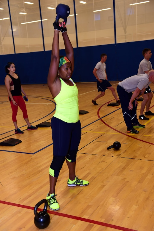 Sandra Stevens, retired military member spouse,  swings a kettlebell Sept. 9, 2016, at the Buckley Fitness Center on Buckley Air Force Base, Colo. The fitness center provides service members, retirees and dependents with different options to stay healthy and fit to fight. (U.S. Air Force photo by Airman 1st Class Gabrielle Spradling/Released)