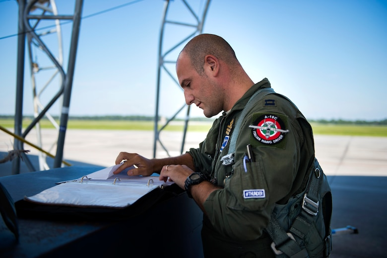 Italian exchange pilot Roberto Manzo, 74th Fighter Squadron training assistant, checks paperwork before a flight, Aug. 25, 2016, at Moody Air Force Base, Ga. In September 2015, Manzo was chosen to participate in the exchange pilot program, which gives American pilots and coalition, or foreign ally, counterparts the opportunity to embed in another fighter squadron and master another airframe. (U.S. Air Force photo by Airman 1st Class Janiqua P. Robinson)