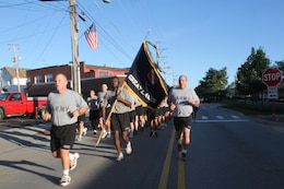 FORT SHERIDAN, Ill. - Army Reserve Brig. Gen. John Hussey from 75th Training Command leads the 9/11 Remembrance 5K run, Sunday, September 11, 2016 in Fort Sheridan. During the run, soldiers and civilians sing military cadences.