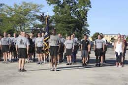 Civilians and soldiers stand together after the 9/11 Remembrance 5K Run, September 11, 2016 in Fort Sheridan.  Runners received a participation medal and t-shirt.