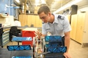 Aeronautical engineering major Cadet 1st Class Kyle Cotton examines a cyclogyro in the Aeronautics Lab, Sept. 12, 2016, at the Air Force Academy. The device is being tested at, and was patented by, the Academy. (U.S. Air Force photo/John Van Winkle)