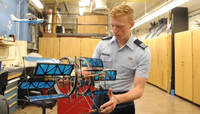Aeronautical engineering major Cadet 1st Class Connor Livingston examines a cyclogyro in the Aeronautics Laboratory, Sept. 12, 2016, at the U.S. Air Force Academy. The cyclogro is being tested at, and was patented by, the Academy. (U.S. Air Force photo/John Van Winkle)