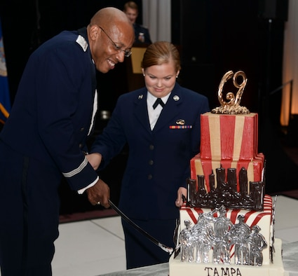 Lt. Gen. Charles Brown, deputy commander assigned to U.S. Central Command, and Airman Kadie Simmons, a customer service technician assigned to the 6th Force Support Squadron, cut the 69th Air Force Ball birthday cake in Tampa, Fla., Sept. 9, 2016. According to tradition, the youngest Airman and the most senior-ranking Airman at the ball cut the Air Force birthday cake. (U.S. Air Force photo by Senior Airman Vernon L. Fowler Jr.)