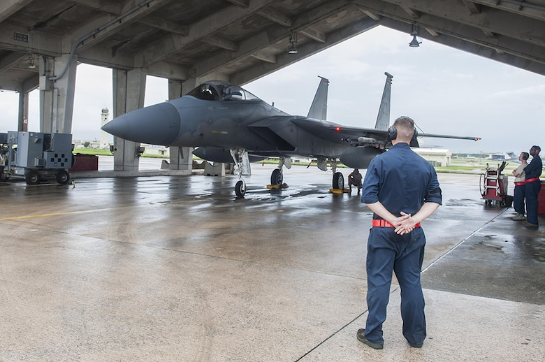 Airman 1st Class Dennis Hatcher, 18th Aircraft Maintenance Squadron crew chief, prepares to guide an F-15 Eagle Sept. 9, 2016, at Kadena Air Base, Japan. F-15 Eagles departed from Kadena in support of Exercise Valiant Shield. Valiant Shield is a joint exercise between the U.S. armed forces which focuses on maintaining land, air, sea and cyberspace dominance in the Pacific.