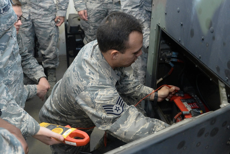 An Airman from the 5th Civil Engineer Squadron electrical power production shop checks the battery level of a generator at Minot Air Force Base, N.D., Sept. 12, 2016. Pre-operation inspections are conducted monthly to ensure the generators are working properly. (U.S. Air Force photo/Airman 1st Class Jessica Weissman)