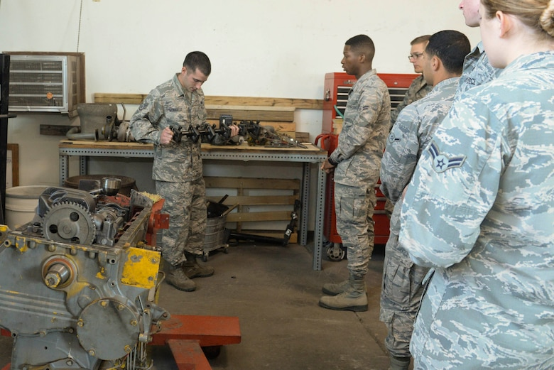 Staff Sgt. Daniel Moravitz, an electrical power production journeyman assigned to the 5th Civil Engineer Squadron, conducts component familiarization training at Minot Air Force Base, N.D., Sept. 12, 2016. The 'power pro' shop maintains generators around base to ensure mission essential buildings and operations are running. (U.S. Air Force photo/Airman 1st Class Jessica Weissman)