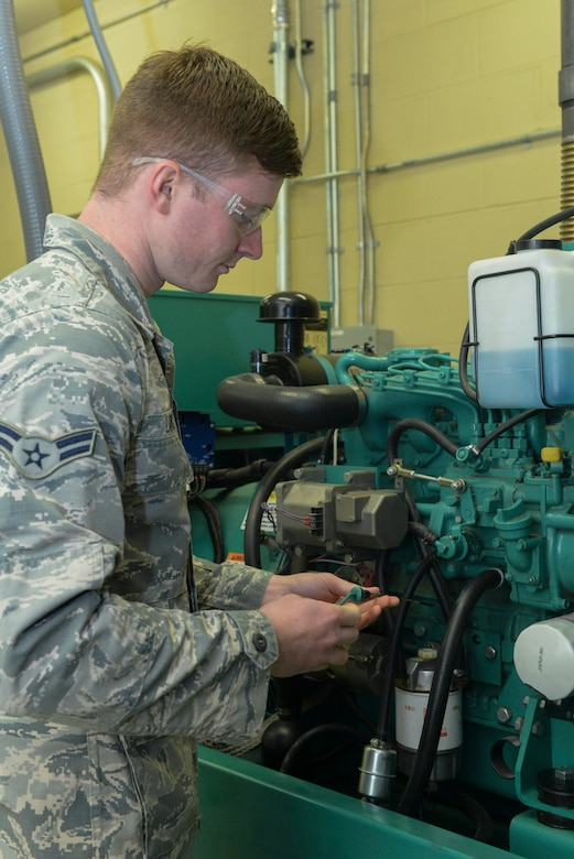 Airman 1st Class Jacob Lang, an electrical power production apprentice assigned to the 5th Civil Engineer Squadron, checks the oil of a generator at Minot Air Force Base, N.D., Sept. 12, 2016. Generators are run monthly to ensure quality and that it can handle the power load required. (U.S. Air Force photo/Airman 1st Class Jessica Weissman)