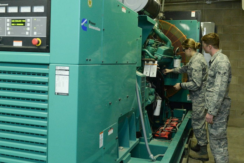 Electrical power production apprentices from the 5th Civil Engineer Squadron conduct a pre-operation inspection on a generator at Minot Air Force Base, N.D., Sept. 12, 2016. Generators around base are inspected and run monthly to ensure they are working properly. (U.S. Air Force photo/Airman 1st Class Jessica Weissman)