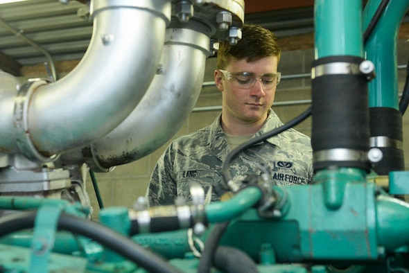 Airman 1st Class Jacob Lang, an electrical power production apprentice assigned to the 5th Civil Engineer Squadron, checks over a generator at Minot Air Force Base, N.D., Sept. 12, 2016. Generators are the backup power source for mission essential buldings on base. (U.S. Air Force photo/Airman 1st Class Jessica Weissman)
