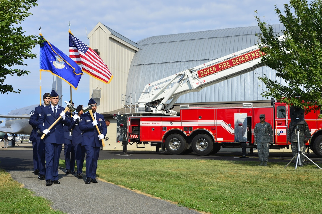 Members from the Dover Air Force Base Honor Guard, 436th Security Forces Squadron and firefighters from the 436th Civil Engineer Squadron march during the 15th Anniversary 9/11 Memorial Service Sept. 11, 2016, at the Air Mobility Command Museum on Dover AFB, Del. The 9/11 Memorial at the museum includes two pieces of steel from the World Trade Center, a rock from the United Airlines Flight 93 crash site and a block from the damaged portion of the Pentagon. (U.S. Air Force photo by Senior Airman William Johnson)