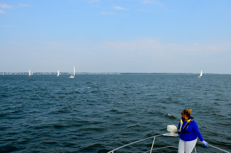 Retired U.S. Air Force Master Sgt. Debra Wesley, Langley Yacht Club race committee score keeper and boatswain mate, watches sailboats while waiting to drop the anchor of the committee boat during the Tri-Services Regatta on Chesapeake Bay, Va., Sept. 11, 2016. The annual race between the U.S Air Force, U.S. Army, U.S. Navy and military-orientated sailing clubs was in remembrance of the 15th anniversary of 9/11. (U.S. Air Force photo by Airman 1st Class Kaylee Dubois)
