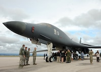 A group of foreign generals and staff members observe a static display of a B-1 bomber at Ellsworth Air Force Base, S.D., Sept. 12, 2016. The event was among five base tours undertaken every six months as a Secretary of Defense-directed engagement for senior military attachés from around the world who are stationed in Washington, D.C. (U.S. Air Force photo by Airman 1st Class Marshall L. Brown)