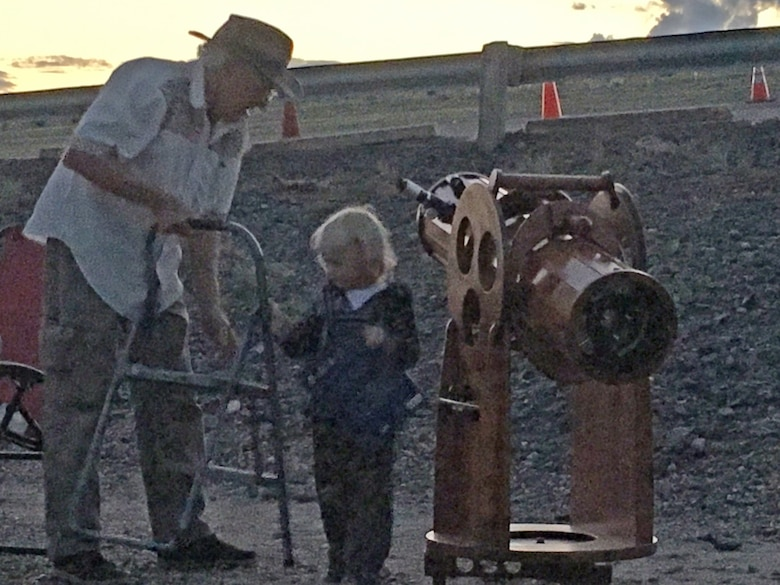 COCHITI LAKE, N.M. -- One of the children gets some help to be able to reach the telescope at the star party, Sept. 3, 2016.