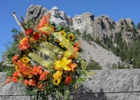 A wreath stands in honor of the 15th anniversary of the attacks on Sept. 11, 2001, at the Mount Rushmore National Memorial, S.D., Sept. 11, 2016. Defense officials from more than 30 countries conducted a wreath laying ceremony in remembrance of the attacks that occurred in New York, Virginia and Pennsylvania. (U.S. Air Force photo by Senior Airman Anania Tekurio)