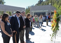 Senior foreign and U.S. attachés stand in silence during a wreath laying ceremony at the Mount Rushmore National Memorial, S.D., Sept. 11, 2016. The ceremony, administered in silence, was conducted in honor of the 15th anniversary of the attacks on Sept. 11, 2001, that occurred in New York, Virginia and Pennsylvania. (U.S. Air Force photo by Senior Airman Anania Tekurio)