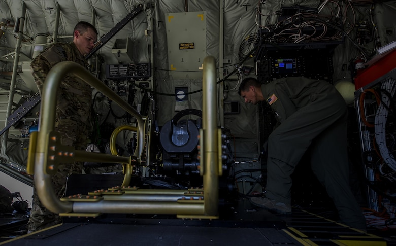 Tech. Sgt. Johnny Hooker and Staff Sgt. Oscar Garcia, aerial gunners with the 1st Special Operations Group Detachment 2, conduct pre-flight inspections of a 105 mm weapon system onboard an AC-130J Ghostrider gunship at Hurlburt Field, Fla., Sept. 8 2016. Pre-flight inspections are performed to ensure the aircraft and its systems are in good condition to fly and perform the mission. (U.S. Air Force photo by Airman 1st Class Isaac O. Guest IV)