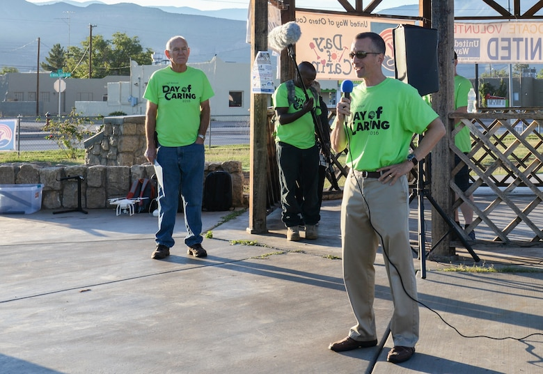 Col. Houston R. Cantwell, the 49th Wing commander, gives an opening speech at the 25th annual Day of Caring volunteer event at Alameda Park in Alamogordo, N.M. on Sept. 9, 2016. The Day of Caring offers support to families, disabled individuals and senior citizens within Otero County communities. (U.S. Air Force photo by Airman Alexis P. Docherty)
