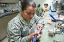 PETERSON AIR FORCE BASE, Colo. - Airman 1st Class Andrea Cañas, a dental laboratory technician from the 21st Dental Squadron, files down high points on a retainer at the Dental Lab at Peterson Air Force Base, Colo., Sept. 12, 2016, to fit properly when worn. Cañas was born in the U.S., but was raised in El Salvador. (U.S. Air Force photo by Philip Carter)
