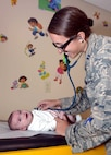 Capt. Megan McDonald, a pediatrician with the 28th Medical Group, performs a check-up on a child at Ellsworth Air Force Base, S.D., Sept. 8, 2016. McDonald graduated from the U.S. Air Force Academy in 2008, and attended medical school at Georgetown University School of Medicine. She later attended pediatric residency training at Dayton Children's Hospital at Wright Patterson Air Force Base, Ohio, the nation's only fully integrated military-civilian residency training program. (U.S. Air Force photo by Airman 1st Class Donald C. Knechtel)