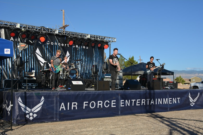 David Cook, the American Idol Season Seven winner, and his band perform a song at Holloman Air Force Base, N.M. on Sept. 11, 2016. The 49th Force Support Squadron hosted the event, which is Cook's 10th Air Force Base he has visited on this tour. (U.S. Air Force photo by Staff Sgt. Warren Spearman)