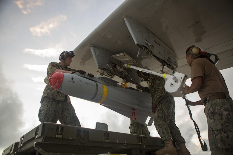 U.S. Navy sailors of Patrol Squadron 46 load a P-3 Orion aircraft with AGM-65F MAVERICKS Air to Surface Missiles prior to a sinking exercise Sept. 13, 2016, at Andersen Air Force Base, Guam, during Valiant Shield 2016. SINKEX provided service members the opportunity to gain proficiency in tactics, targeting, and live firing against a surface target at sea. Valiant Shield is a biennial, U.S. -only field-training exercise with a focus on integration of joint training among U.S. forces. (U.S. Marine Corps photo by Sgt. Justin Fisher)