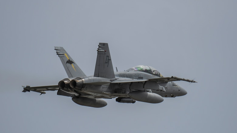 A U.S. Marine F-18 Hornet assigned to Marine All-Weather Fighter Attack Squadron 242, from Marine Corps Air Station Iwakuni, Japan, takes off during Exercise Valiant Shield at Andersen Andersen Air Force Base, Guam, Sept. 14, 2016. Valiant Shield is a biennial U.S. Air Force, Navy and Marine Corps exercise held in Guam, focusing on real-world proficiency in sustaining joint forces at sea, in the air, on land and in cyberspace. (U.S. Air Force photo by Tech. Sgt. Richard P. Ebensberger)