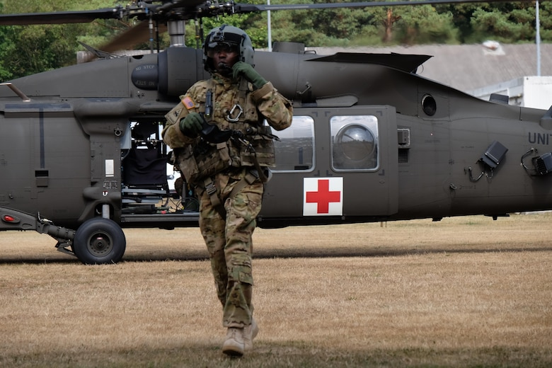 KAISERSLAUTERN, Germany — 7th Mission Support Command Soldiers from the Medical Support Unit-Europe conduct medical evacuation training with Staff Sgt. Jessie Turner, flight medic with the 1st Armored Division's Combat Aviation Brigade, Sept. 9, 2016.  (Photo by Sgt. 1st Class Matthew Chlosta, 7th MSC Public Affairs Office)