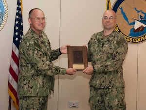 (Sept. 7, 2016) Rear Adm. Eugene Black, deputy commander of U.S. Naval Forces Central Command (NAVCENT) presents the Admiral Stanley R. Arthur Award for Logistics Excellence to Lt. Nathan Peck, a native of Orlando, Fla. assigned to Commander, Task Force (CTF) 53, aboard Naval Support Activity Bahrain. Peck was selected as the Logistician of the Year for the 2015 Adm. Stanley R. Arthur Award, which was established in 1997 as an annual award to recognize both individuals and teams that exemplify logistics professionalism and excellence.