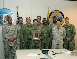Members of U.S. Naval Forces Central Command's (NAVCENT)  Commander, Task Force (CTF) 51, are presented the 2015 Adm. Stanley R. Arthur Logistics Team Award aboard Naval Support Activity Bahrain. The Adm. Stanley R. Arthur Award was established in 1997 as an annual award to recognize both individuals and teams that exemplify logistics professionalism and excellence.