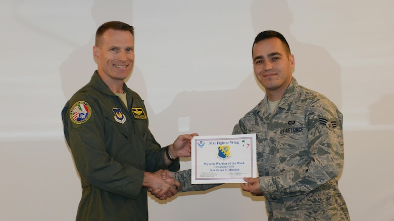 "Brig. Gen. Lance Landrum, 31st Fighter Wing commander, names Senior Airman Steven Misetich, 31st Operations Support Squadron weather journeyman, the ""Wyvern Warrior of the Week"" at Aviano Air Base, Italy on Sept. 14, 2016. Misetich was recognized for his performance in a recent joint exercise and exemplifying the Air Force core value. (U.S. Air Force photo by Staff Sgt. Andrew M. Satran/Released)"