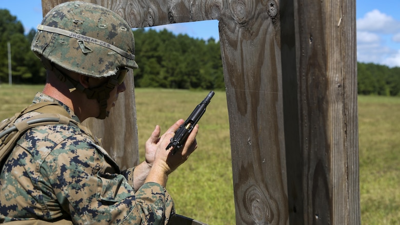 Cpl. Joshua Hodel, Stone Bay target shed noncommissioned officer in charge, conducts a speed reload with the M9 service pistol during a 3-gun shooting competition coordinated by the Combat Marksmanship Trainer Course at Stone Bay on Marine Corps Base Camp Lejeune, N.C., Sept. 1, 2016. The competition enabled CMT students to become familiar with how to set up and run a range and range personnel were also able to hone their marksmanship skills.