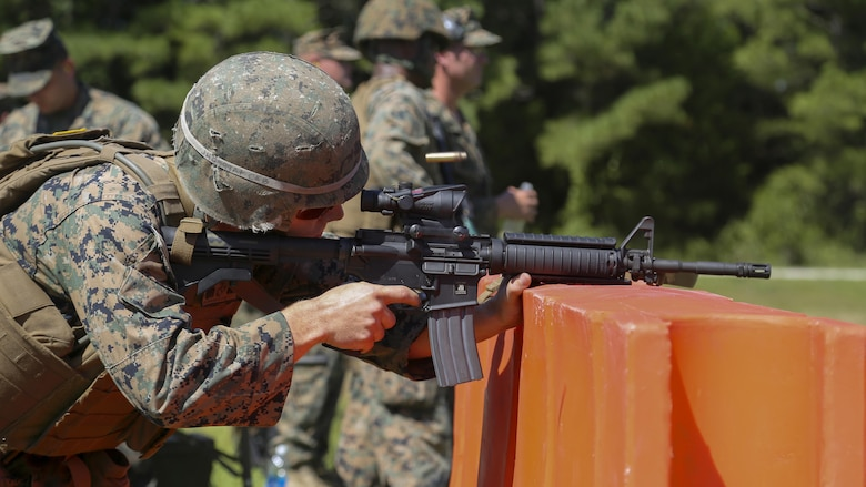 Cpl. Joshua Hodel, Stone Bay target shed noncommissioned officer in charge, fires an M4 service rifle in a 3-gun shooting competition coordinated by the Combat Marksmanship Trainer Course at Stone Bay on Marine Corps Base Camp Lejeune, N.C., Sept. 1, 2016. The competition enabled CMT students to become familiar with how to set up and run a range and range personnel were also able to hone their marksmanship skills.