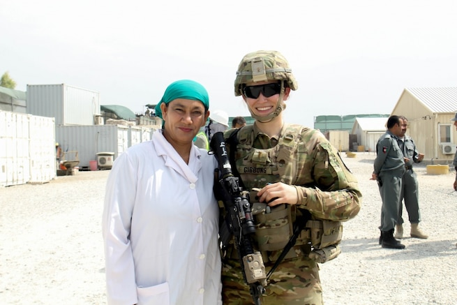 Army 2nd Lt. Eva Gibbons, assigned to the 3rd Cavalry Regiment, stands with Yassmin, her Afghan counterpart, during an advising engagement at the 202nd Police Zone Regional Training Center in Nangarhar province, Afghanistan, July 14, 2016. Yassmin is a doctor, and is currently the only female working at the RTC