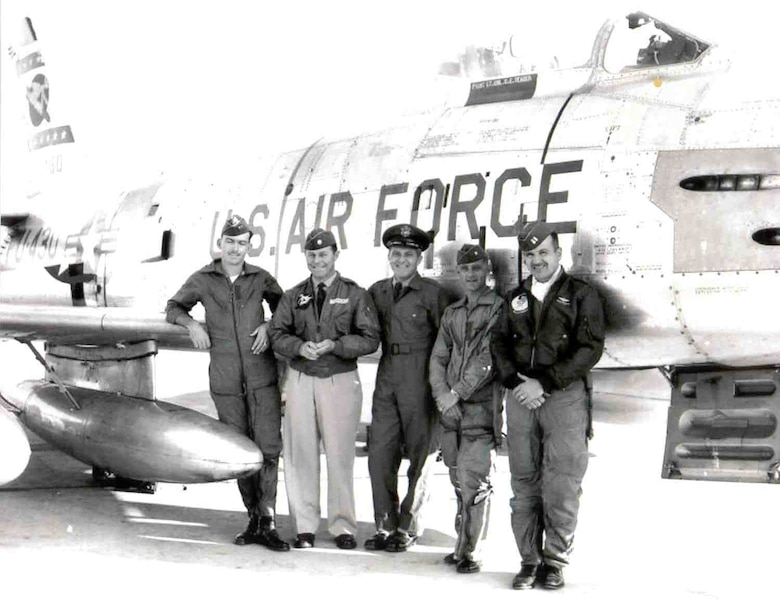 "Then-Lt. Col. Charles ""Chuck"" Yeager (second from left) poses for a photo with his team following their U.S. Air Forces in Europe fighter competition win in 1956. Yeager was the commander for the 417th Fighter"