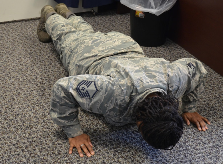 Master Sgt. Altrameise Myers, a knowledge management specialist at the 920th Communications Flight, does 22 pushups in her office at Patrick Air Force Base, Fla., Sept. 12, 2016. The 22 Pushup Challenge emerged to raise awareness about the 22 veterans who die by suicide on average each day, according to a Department of Veterans Affairs report. (U.S. Air Force photo by 1st Lt. Anna-Marie Wyant)