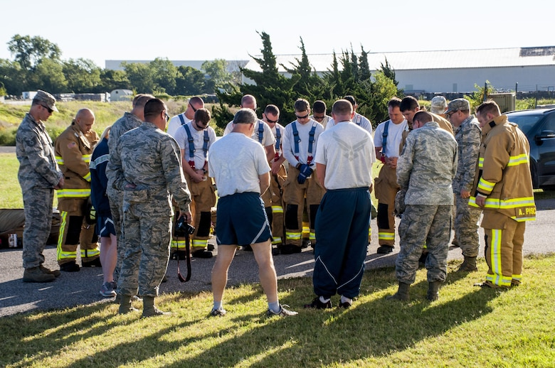 Okie firefighters from the 507th Civil Engineer Squadron and other Reservists from the 507th Air Refueling Wing pray before beginning their 7th annual fire climb Sept. 11, 2016, at Tinker Air Force Base, Okla. To remember the victims and heroes who perished 15 years ago, Reservists climb up and down the fire-training tower to complete the 18 laps within 56 minutes, the amount of time it took the South Tower of the World Trade Center to collapse. (U.S. Air Force photo/Master Sgt. Grady Epperly)