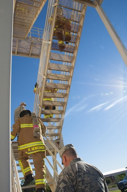 Okie firefighters from the 507th Civil Engineer Squadron hike up the stairs of the fire training tower Sept. 11, 2016, at Tinker Air Force Base, Okla., during their 7th annual fire climb, held to honor the victims and heroes who perished on that day 15 years ago. Every year, Reservists climb up and down the fire-training tower to complete the 18 laps within 56 minutes, the amount of time it took the South Tower of the World Trade Center to collapse. (U.S. Air Force photo/Master Sgt. Grady Epperly)