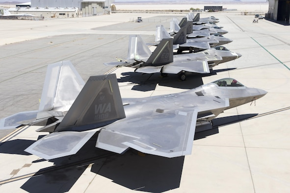 Seven F-22A Raptors sit outside the 411th Flight Test Squadron Aug. 10. Four operational jets from three different bases are at Edwards for testing to help improve the long-term combat capability of the F-22 Raptor. (U.S. Air Force photo by Christian Turner)