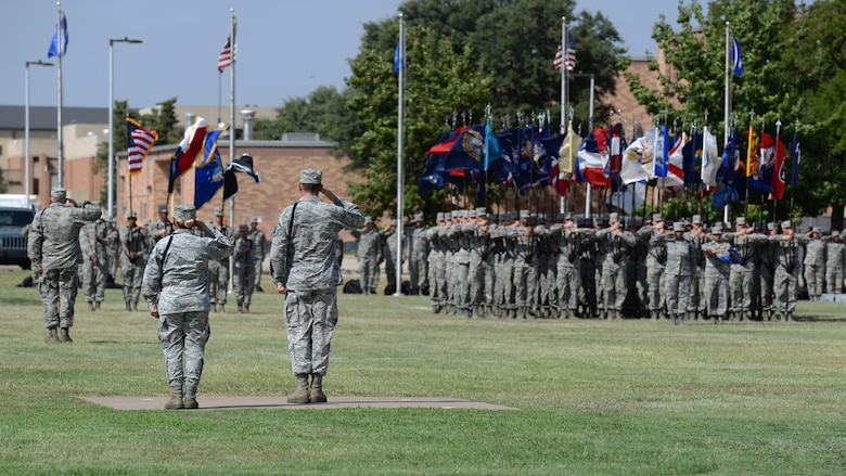Airmen at Sheppard Air Force Base, Texas, render a salute during the playing of the National Anthem as part of the POW MIA parade, Sept. 9, 2016. Nearly 75 percent of missing Americans are located in the Asia-Pacific area. (U.S. Air Force photo by Senior Airman Kyle E. Gese)