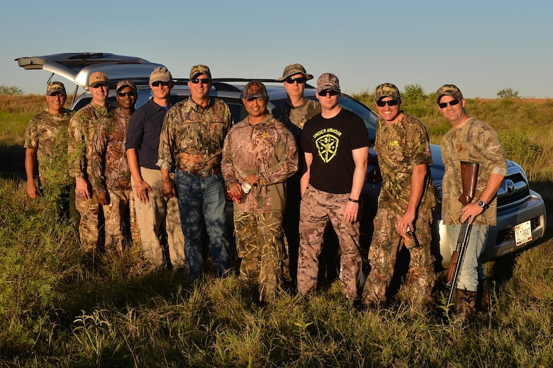 Brig. Gen. Patrick Doherty, 82nd Training Wing commander, and Chief Master Sgt. Joseph Pritchard, 82nd TRW command chief, stand with base leadership after their dove hunt in Henrietta, Texas, Sept. 10, 2016. Nearly 175 Airmen were invited to the 12th Annual Clay County Dove Salute at the Birdwell and Clark Ranch. (U.S. Air Force photo by Senior Airman Kyle E. Gese)