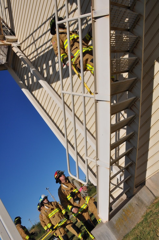 Okie firefighters from the 507th Civil Engineer Squadron climb the stairs of the fire training tower during their 7th annual fire climb Sept. 11, 2016, at Tinker Air Force Base, Okla. Each year, Reservists climb up and down the fire-training tower to complete the 18 laps within 56 minutes, the amount of time it took the South Tower of the World Trade Center to collapse. (U.S. Air Force photo/Master Sgt. Grady Epperly)