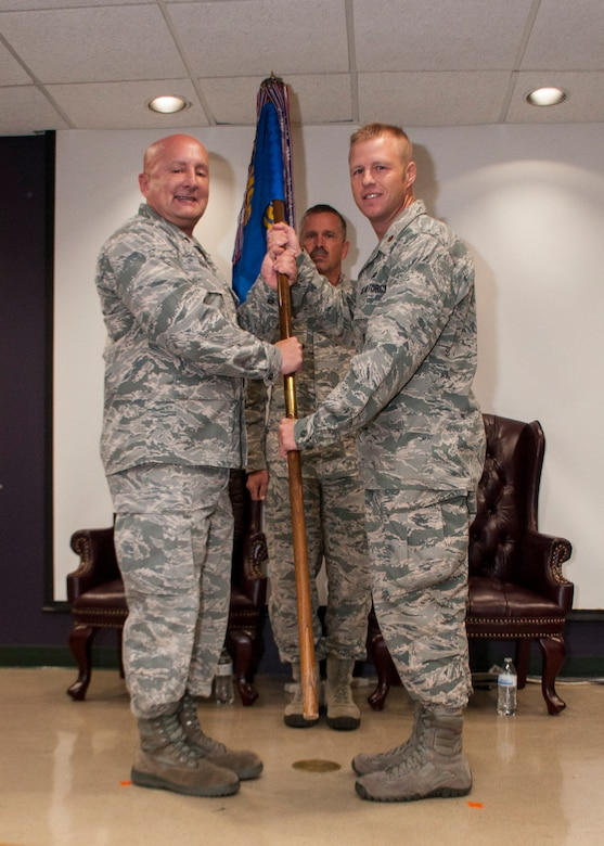 Lt. Col. Richard Ropac, 507th Mission Support Group commander, passes the guidon to Maj. Ricky Martin II, new commander of the 507th Security Forces Squadron, at his assumption of command ceremony Sept. 11, 2016, at Tinker Air Force Base, Oklahoma. Martin has served in various capacities to include: nuclear security, presidential support, antiterrorism, security forces operations, Iraqi Police transition team and contingency operations. Martin has also worked as a Federal Reserve Law Enforcement Officer in Salt Lake, Utah.  Prior to arriving at Tinker, Martin commanded the 99th Security Forces Squadron at Nellis Air Force Base, Nevada, comprised of 350 military and civilian personnel. (U.S. Air Force photo/Master Sgt. Grady Epperly)