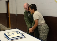 Col. Bradley Cochran, vice commander assigned to the 28th Bomb Wing, and Airman Stacy Acosta, an airfield management apprentice with the 28th Operations Support Squadron, cut cake during the combat dining out at Ellsworth Air Force Base, S.D., Sept. 9, 2016. Acosta, the youngest Airman on base, was bestowed the honor of cutting the cake during the dining out in celebration of the U.S. Air Force's heritage and 69th birthday. (U.S. Air Force photo by Airman 1st Class Donald C. Knechtel)
