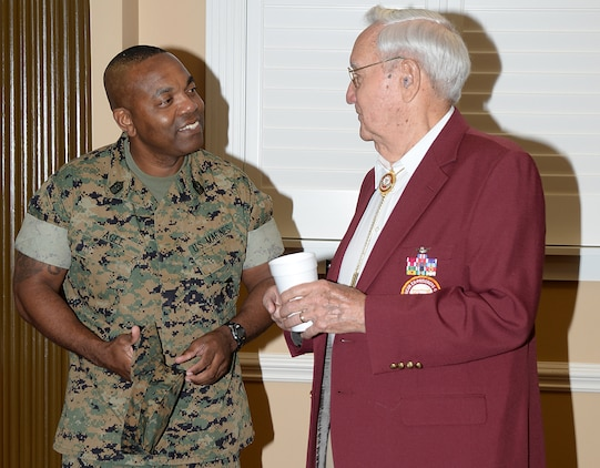 Sergeant Major Kenneth Agee, base sergeant major, MCLB Albany, greets Retired Army Col. Quin Herlik, guest of honor for the POW/MIA Recognition Breakfast, Sept. 9.