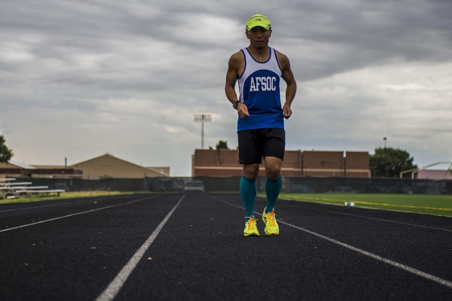 Tech. Sgt. Ming Ni, 27th Special Operations Logistics Readiness Squadron Fleet Management and Analysis, runs on the track Sept. 6, 2016 at Cannon Air Force Base, N.M. Ni is scheduled to represent Air Force Special Operations Command in the Air Force Marathon at Wright-Patterson Air Force Base, Ohio., Sept. 17, 2016. (U.S. Air Force Photo/Tech. Sgt. Manny Martinez)