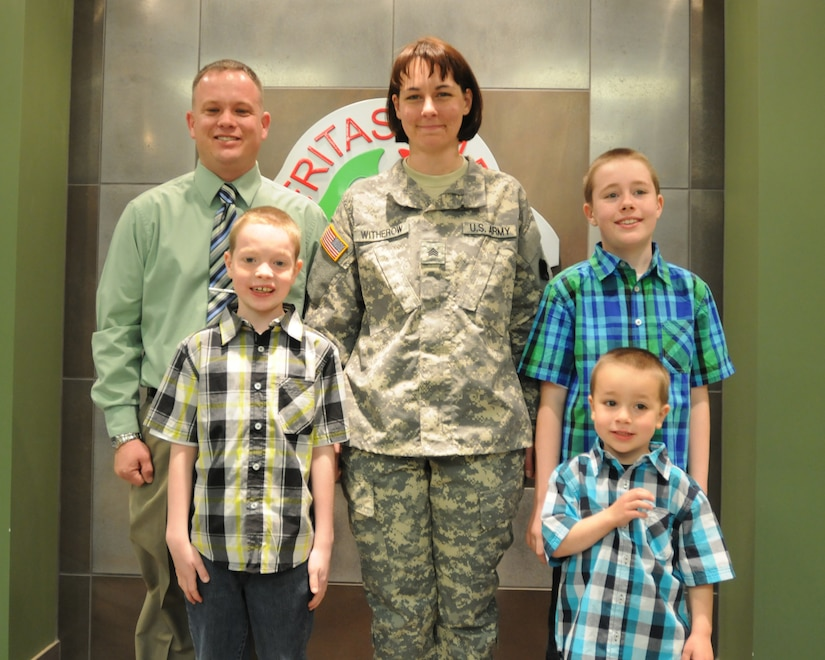 Sgt. Rachelle Witherow and her family pose for a photo after her promotion ceremony at the 88th RSC Headquarters on Fort McCoy, Wis., April 3, 2015. (U.S. Army Reserve photo courtesy of Sgt. 1st Class Corey Beal)